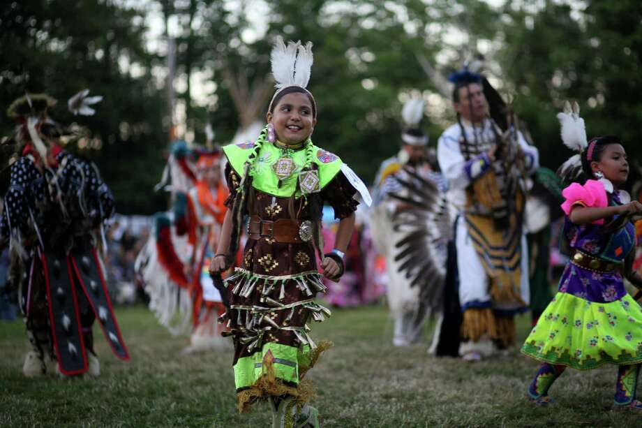 Dancers perform during the Seafair Indian Days Pow Wow at Daybreak Star in Discovery Park on Friday, July 19, 2013 in Seattle. One year after the event was cancelled because of a lack of funding, the pow wow returned with much fanfare and a grand entry on Friday evening. The event brings Native dancers and drummers from around North America where the dancers compete in their impressive regalia during the event. The pow wow also features Native arts vendors and food booths. You can find more info about the pow wow by clicking here. Photo: JOSHUA TRUJILLO, SEATTLEPI.COM / SEATTLEPI.COM