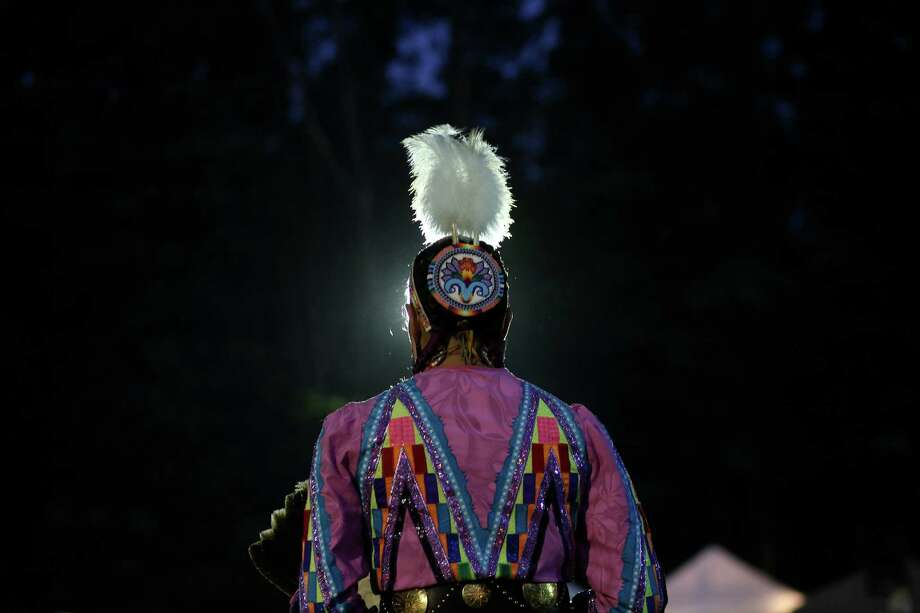 A dancer waits to perform during the Seafair Indian Days Pow Wow at Daybreak Star in Discovery Park on Friday, July 19, 2013 in Seattle. One year after the event was cancelled because of a lack of funding, the pow wow returned with much fanfare and a grand entry on Friday evening. The event brings Native dancers and drummers from around North America where the dancers compete in their impressive regalia during the event. The pow wow also features Native arts vendors and food booths. Photo: JOSHUA TRUJILLO, SEATTLEPI.COM / SEATTLEPI.COM