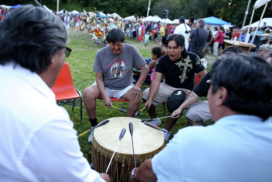Drummers perform during the Seafair Indian Days Pow Wow at Daybreak Star in Discovery Park on Friday, July 19, 2013 in Seattle. One year after the event was cancelled because of a lack of funding, the pow wow returned with much fanfare and a grand entry on Friday evening. The event brings Native dancers and drummers from around North America where the dancers compete in their impressive regalia during the event. The pow wow also features Native arts vendors and food booths. Photo: JOSHUA TRUJILLO, SEATTLEPI.COM / SEATTLEPI.COM