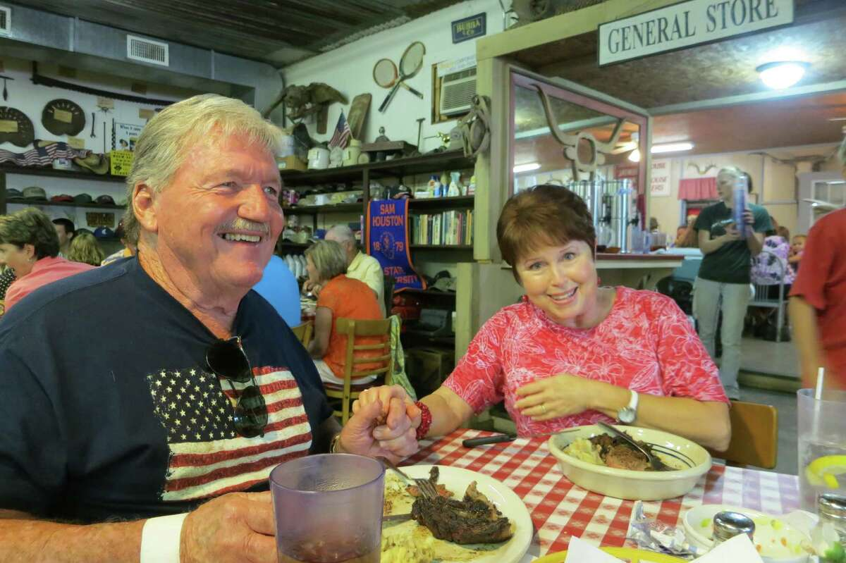 """Smitty and Candy Zunker share a ribeye for their anniversary at Leona General Store near Centerville. """"We like the waitresses,"""" Candy said of the student servers."""