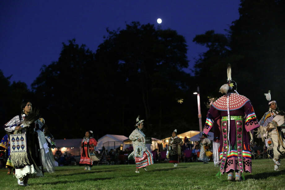 Dancers perform during the Seafair Indian Days Pow Wow at Daybreak Star in Discovery Park on Friday, July 19, 2013 in Seattle. One year after the event was cancelled because of a lack of funding, the pow wow returned with much fanfare and a grand entry on Friday evening. The event brings Native dancers and drummers from around North America where the dancers compete in their impressive regalia during the event. The pow wow also features Native arts vendors and food booths. Photo: JOSHUA TRUJILLO, SEATTLEPI.COM / SEATTLEPI.COM