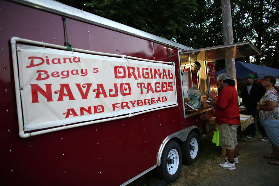 Navajo Tacos are sold during the Seafair Indian Days Pow Wow at Daybreak Star in Discovery Park on Friday, July 19, 2013 in Seattle. One year after the event was cancelled because of a lack of funding, the pow wow returned with much fanfare and a grand entry on Friday evening. The event brings Native dancers and drummers from around North America where the dancers compete in their impressive regalia during the event. The pow wow also features Native arts vendors and food booths. Photo: JOSHUA TRUJILLO, SEATTLEPI.COM / SEATTLEPI.COM