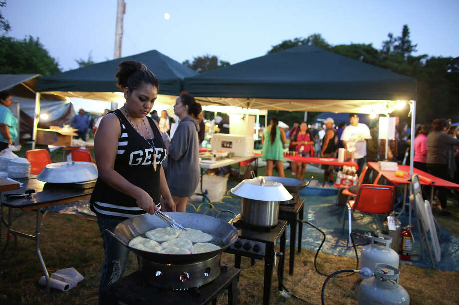 Amy Olive makes fry bread during the Seafair Indian Days Pow Wow at Daybreak Star in Discovery Park on Friday, July 19, 2013 in Seattle. One year after the event was cancelled because of a lack of funding, the pow wow returned with much fanfare and a grand entry on Friday evening. The event brings Native dancers and drummers from around North America where the dancers compete in their impressive regalia during the event. The pow wow also features Native arts vendors and food booths. Photo: JOSHUA TRUJILLO, SEATTLEPI.COM / SEATTLEPI.COM