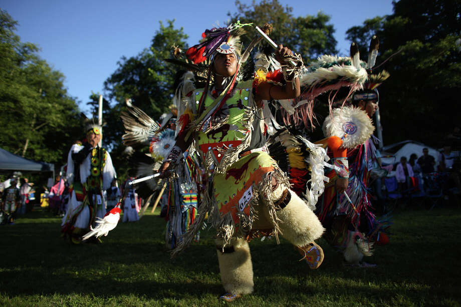 A dancers performs during the Seafair Indian Days Pow Wow at Daybreak Star in Discovery Park on Friday, July 19, 2013 in Seattle. One year after the event was cancelled because of a lack of funding, the pow wow returned with much fanfare and a grand entry on Friday evening. The event brings Native dancers and drummers from around North America where the dancers compete in their impressive regalia during the event. The pow wow also features Native arts vendors and food booths. Photo: JOSHUA TRUJILLO, SEATTLEPI.COM / SEATTLEPI.COM