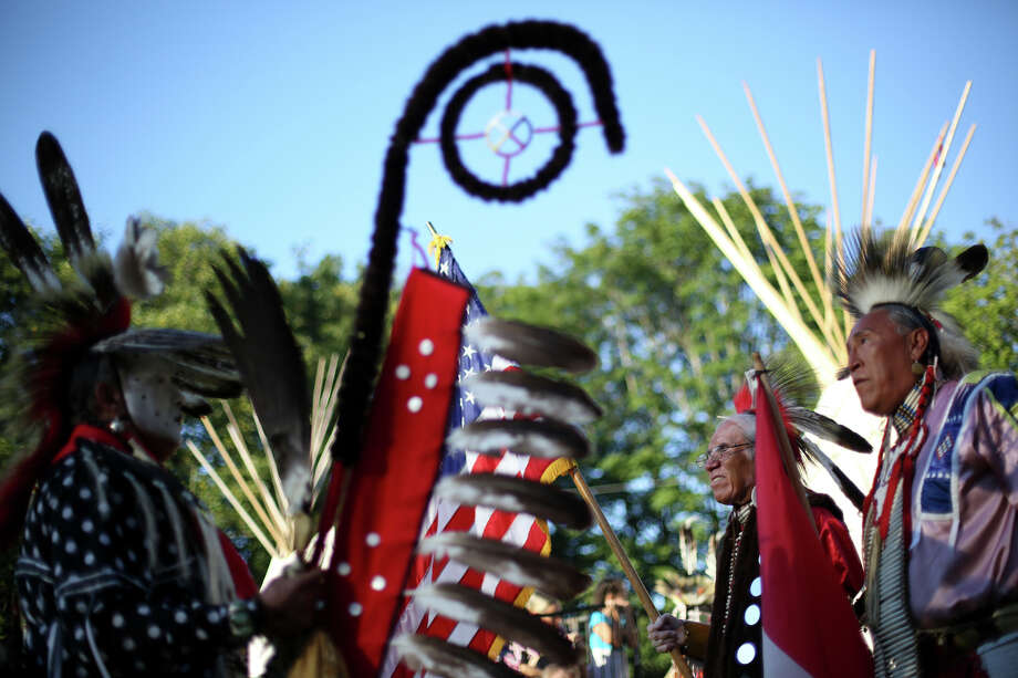 Participants wait to take part in the Grand Entry during the Seafair Indian Days Pow Wow at Daybreak Star in Discovery Park on Friday, July 19, 2013 in Seattle. One year after the event was cancelled because of a lack of funding, the pow wow returned with much fanfare and a grand entry on Friday evening. The event brings Native dancers and drummers from around North America where the dancers compete in their impressive regalia during the event. The pow wow also features Native arts vendors and food booths. Photo: JOSHUA TRUJILLO, SEATTLEPI.COM / SEATTLEPI.COM