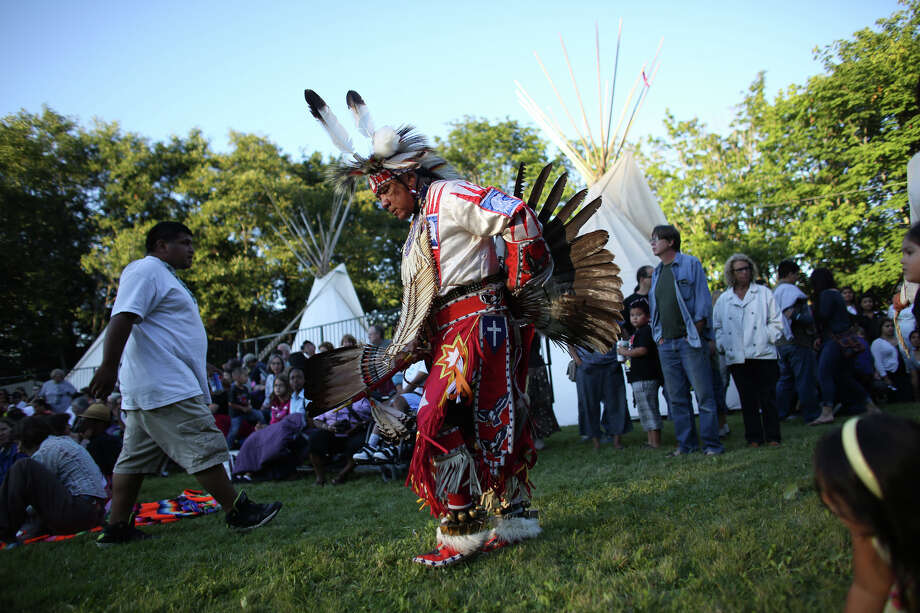 A performer enters the performance area during the Seafair Indian Days Pow Wow at Daybreak Star in Discovery Park on Friday, July 19, 2013 in Seattle. One year after the event was cancelled because of a lack of funding, the pow wow returned with much fanfare and a grand entry on Friday evening. The event brings Native dancers and drummers from around North America where the dancers compete in their impressive regalia during the event. The pow wow also features Native arts vendors and food booths. Photo: JOSHUA TRUJILLO, SEATTLEPI.COM / SEATTLEPI.COM