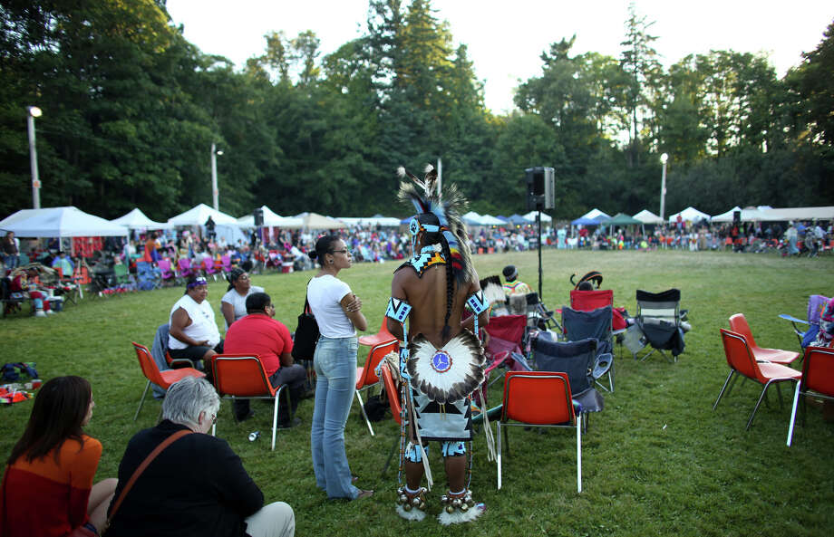 Participants wait for the next performance during the Seafair Indian Days Pow Wow at Daybreak Star in Discovery Park on Friday, July 19, 2013 in Seattle. One year after the event was cancelled because of a lack of funding, the pow wow returned with much fanfare and a grand entry on Friday evening. The event brings Native dancers and drummers from around North America where the dancers compete in their impressive regalia during the event. The pow wow also features Native arts vendors and food booths. Photo: JOSHUA TRUJILLO, SEATTLEPI.COM / SEATTLEPI.COM