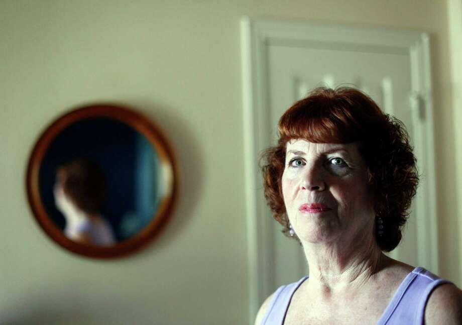 Virginia Stein, 67, pictured July 2, 2013, at her Murphy, Texas home, didn't sign up for Medicare Part B at age 65 because she was covered by her husband's insurance and didn't know there would be a penalty for delaying two years. Now she is attempting to get the penalty removed. (Sonya Hebert-Schwartz/Dallas Morning News/MCT) Photo: Sonya Hebert-Schwartz / Dallas Morning News