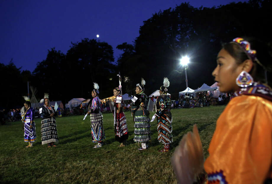 Dancers wait to be judged during the Seafair Indian Days Pow Wow at Daybreak Star in Discovery Park on Friday, July 19, 2013 in Seattle. One year after the event was cancelled because of a lack of funding, the pow wow returned with much fanfare and a grand entry on Friday evening. The event brings Native dancers and drummers from around North America where the dancers compete in their impressive regalia during the event. The pow wow also features Native arts vendors and food booths. Photo: JOSHUA TRUJILLO, SEATTLEPI.COM / SEATTLEPI.COM