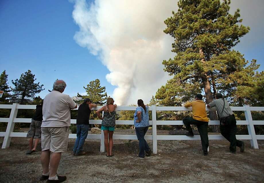 Residents of Pine Cove watch smoke rise from a wildfire near Idyllwild (Riverside County). Evacuation orders remain in place for about 6,000 people. Photo: Richard Lui, Associated Press