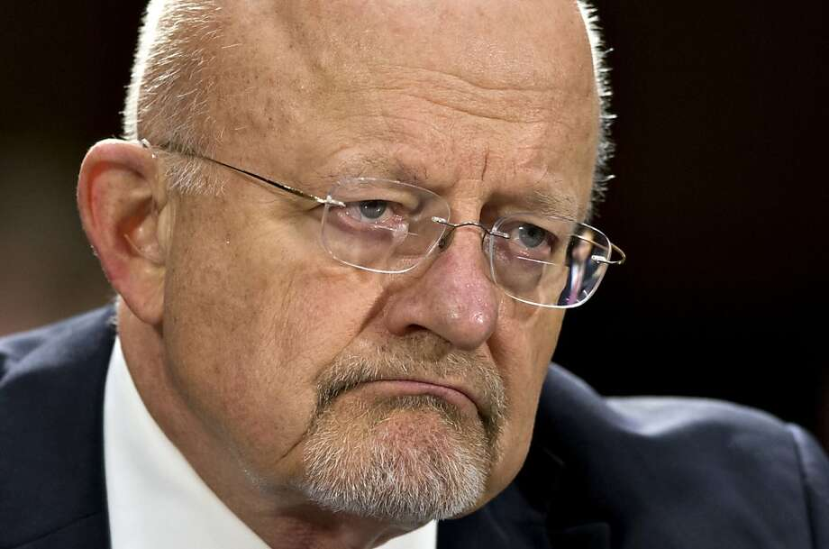 FILE - In this April 18, 2013 file photo, National Intelligence Director James Clapper testifies on Capitol Hill in Washington. The White House and key lawmakers are standing by Clapper despite his admission that he gave misleading statements to Congress on the how much the U.S. spies on its own. Clapper's apology to lawmakers was made public the first week in July. In March he said that U.S. spies do not gather data on Americans _ something National Security Agency leaker Edward Snowden revealed as false by releasing documents showing the NSA collects millions of U.S. phone records (AP Photo/J. Scott Applewhite, File) Photo: J. Scott Applewhite, Associated Press