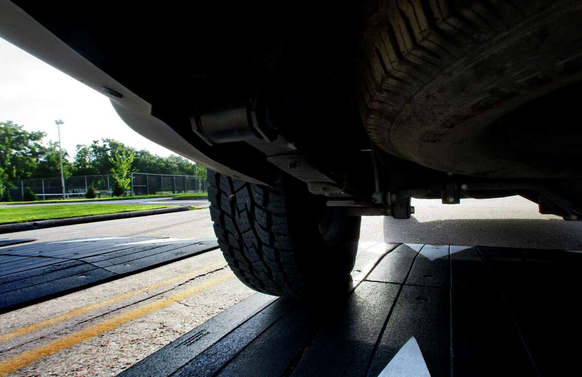 A camera mounted under a vehicle captures a speed bump on Houston's Briarhills Parkway.