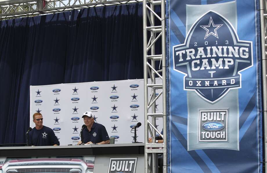 Dallas Cowboys owner Jerry Jones (right) and head coach Jason Garrett hold a press conference at the team's training camp facility in Oxnard, California on Saturday, July 20, 2013. Players will start camp workouts on Sunday.