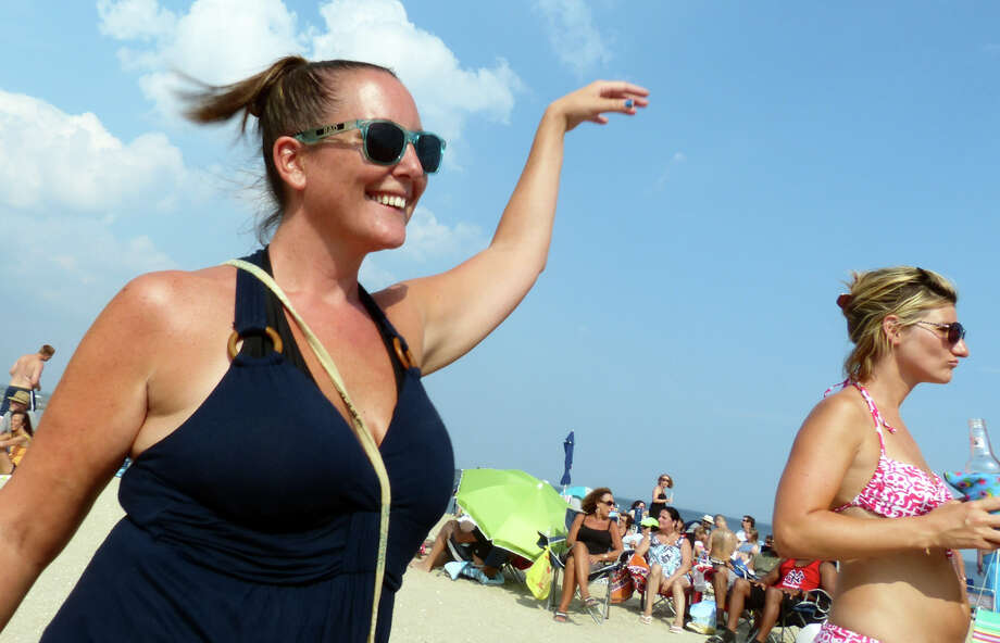 Michelle Cairella, of Seymour, dances as the band Primetime performs during the Blues on the Beach concert at Short Beach in Stratford, Conn. on Saturday July 20, 2013 Photo: Christian Abraham / Connecticut Post