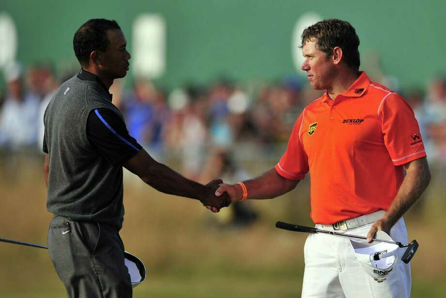 England's Lee Westwood, right, knows he has to get past  Tiger Woods today if he hopes to end his 20-year pursuit of a major championship. Westwood has a two-shot lead over Woods, who is trying to win his 15th major. Photo: GLYN KIRK, Stringer / AFP