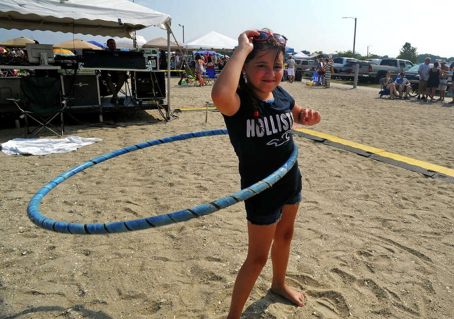 Britney Szarmach, 9, of Stratford, plays with her hula hoop during the Blues on the Beach concert at Short Beach in Stratford, Conn. on Saturday July 20, 2013 Photo: Christian Abraham / Connecticut Post