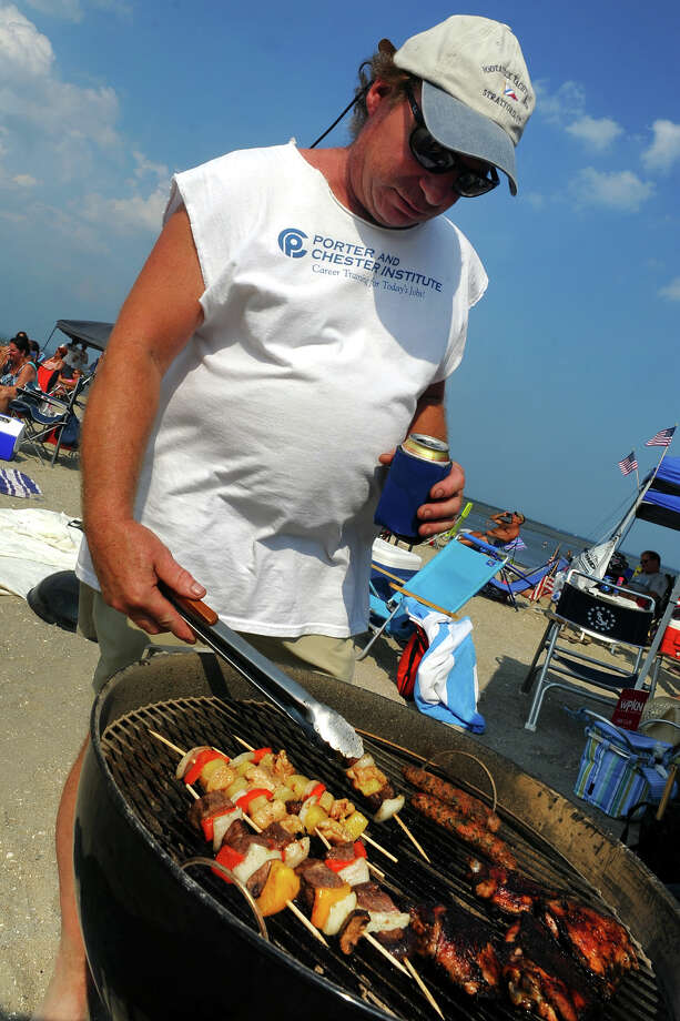 Marty Bruno, of Stratford, does some grilling during the Blues on the Beach concert at Short Beach in Stratford, Conn. on Saturday July 20, 2013 Photo: Christian Abraham / Connecticut Post