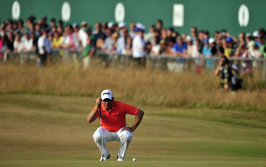 Lee Westwood lines up his putt on No. 18 at Muirfield. He parred the hole for a 1-under 70 and leads after three rounds. Photo: Glyn Kirk, AFP/Getty Images