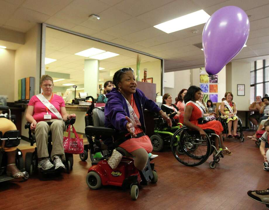 Ms. Wheelchair Florida, Lisa Jackson, plays with a balloon with patients as the contestants from the Ms. Wheelchair America 2014 pageant visited The Institute for Rehabilitation and Research at Memorial Hermann Hospital. Photo: Karen Warren, Houston Chronicle / © 2013 Houston Chronicle