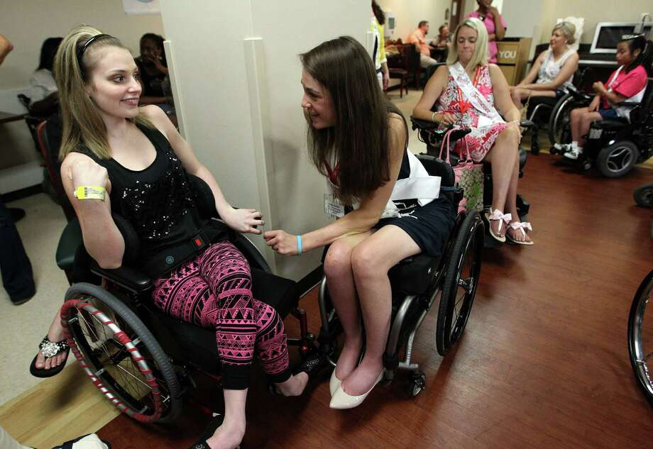 Ms Wheelchair Pennsylvania, Katie Smith, left, talks with TIRR patient Harley Regenbrecht, 18, as the contestants from the Ms. Wheelchair America 2014 pageant visit The Institute for Rehabilitation and Research at Memorial Hermann Hospital. Photo: Karen Warren, Houston Chronicle / © 2013 Houston Chronicle
