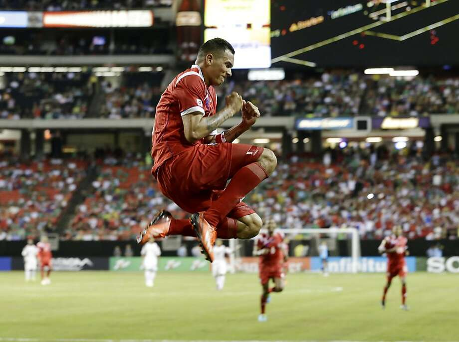 Panama's Blas Perez (7) celebrates his goal against Cuba, one of many in a 6-1 Gold Cup win. Photo: John Bazemore, Associated Press