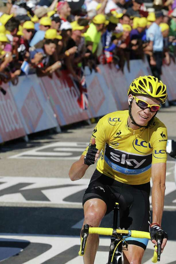 It's all good for Britain's Chris Froome as the overall leader in the Tour de France crosses the finish line at the end of the 20th and next-to-last stage. Photo: JOEL SAGET, Staff / AFP