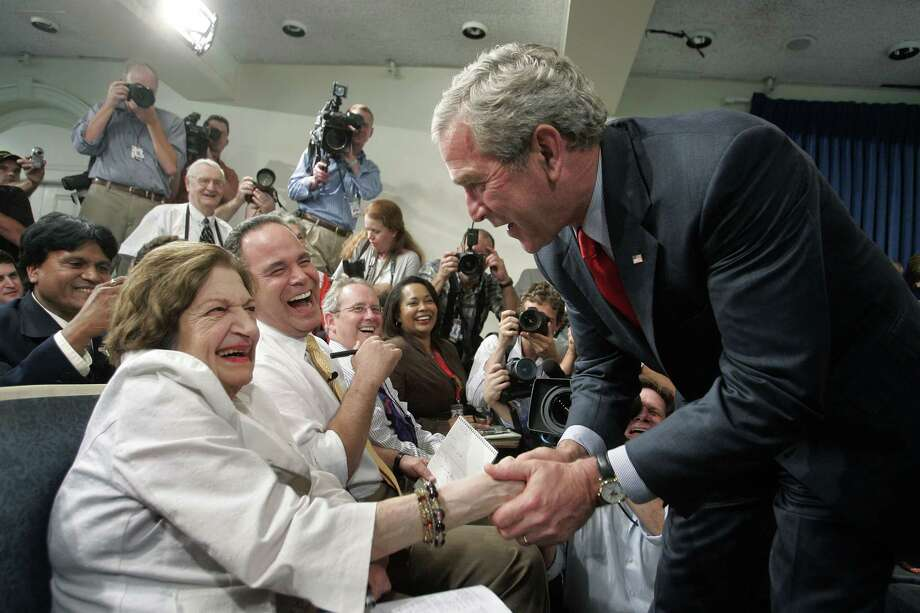 In this Aug. 2, 2006, file photo, President Bush, right, greets veteran White House correspondent Helen Thomas during the final briefing in the press briefing room in the West Wing of the White House in Washington before its renovation. Thomas, a pioneer for women in journalism and an irrepressible White House correspondent, has died Saturday, July 20, 2013. She was 92. Photo: Charles Dharapak, Associated Press / AP