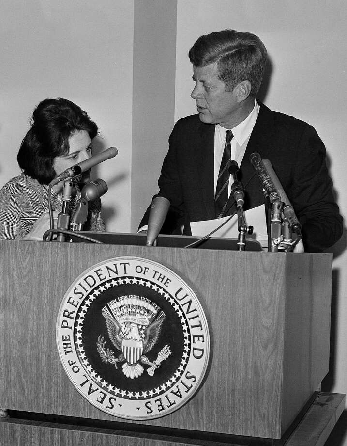 In this May 12, 1963, file photo, reporter Helen Thomas asks President John F. Kennedy for copies of his announcement pledging Federal power to preserve order and lives in Birmingham, Ala., during a news conference at the White House in Washington. Thomas, a pioneer for women in journalism and an irrepressible White House correspondent, has died Saturday, July 20, 2013. She was 92. Photo: Bill Allen, Associated Press / AP