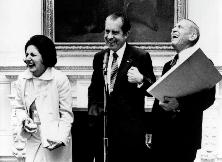 In this Sept. 30, 1971, file photo, President Richard Nixon laughs with UPI reporter Helen Thomas, left, and AP reporter Douglas Cornell during an impromptu reception in Washington. Thomas, a pioneer for women in journalism and an irrepressible White House correspondent, has died Saturday, July 20, 2013. She was 92. Photo: Uncredited, Associated Press / AP