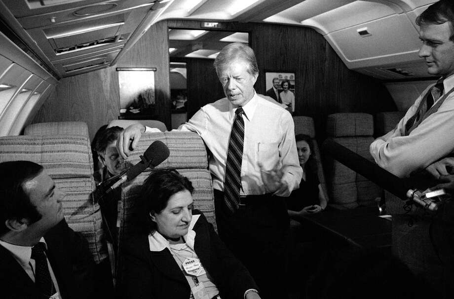 In this Oct. 20, 1979, file photo, President Jimmy Carter and press secretary Jody Powell, right, talk with reporters Helen Thomas, center, and Sam Donaldson, left, while aboard Air Force One prior to landing at Andrews Air Force Base, Md. Thomas, a pioneer for women in journalism and an irrepressible White House correspondent, has died Saturday, July 20, 2013. She was 92. Photo: Charles Tasnadi, Associated Press / AP