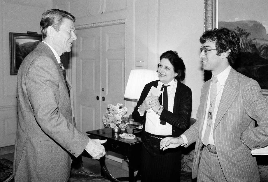 In this April 13, 1981, file photo, President Ronald Reagan greets UPI reporter Helen Thomas, center, and AP reporter Jim Gerstenzang, right, before an interview in the Treaty Room of the White House in Washington. Thomas, a pioneer for women in journalism and an irrepressible White House correspondent, has died Saturday, July 20, 2013. She was 92. Photo: Barry Thumma, Associated Press / AP