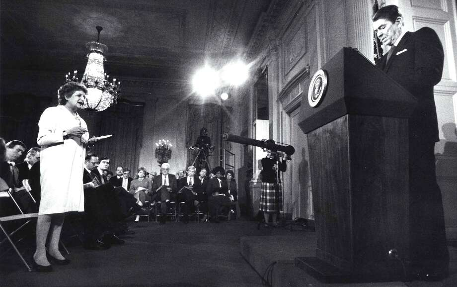This file photo shows reporter Helen Thomas as she questions former US President Ronald Reagan during a press conference at the White House 19 March,1987 in Washington, DC. This was the first press conference that Reagan had held since 19 November 1986, six days before the disclosure that profits from arm sales to Iran were diverted to the Contras. Photo: DON RYPKA, AFP/Getty Images / AFP