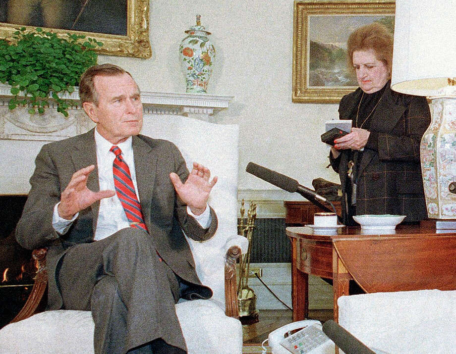 In this Jan. 21, 1989, file photo, President George H. Bush speaks with reporters, including Helen Thomas, right, in Washington. Thomas, a pioneer for women in journalism and an irrepressible White House correspondent, has died Saturday, July 20, 2013. She was 92. Photo: Doug Mills, Associated Press / AP