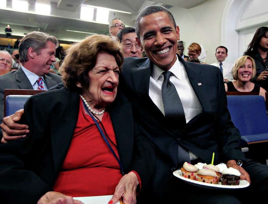 In this Aug. 4, 2009, file photo, veteran White House reporter Helen Thomas, left, celebrates her 89th birthday with President Barack Obama, celebrating his 48th birthday, in the White House Press Briefing Room in Washington. Thomas, a pioneer for women in journalism and an irrepressible White House correspondent, has died Saturday, July 20, 2013. She was 92. Photo: J. Scott Applewhite, Associated Press / AP