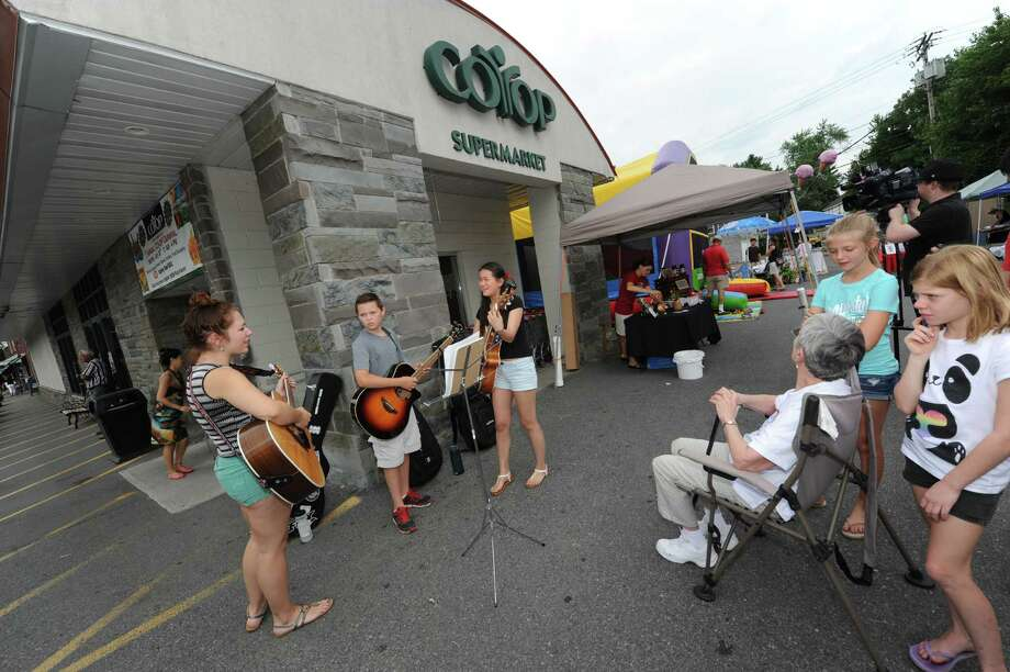 Right to left, Emily Costa, Riley Olena and Sadie Buerker perform during the Niskayuna Co-Op Annual Summer Carnival to benefit the Schenectady Inner City Ministries Food Pantry on Saturday July 20, 2013 in Niskayuna, N.Y. (Michael P. Farrell/Times Union) Photo: Michael P. Farrell / 00023208A