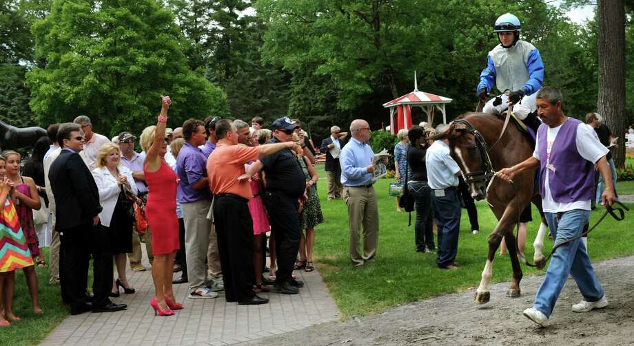 Courageous Karen, with David Cohen up, parades through the paddock on Saturday, July 20, 2013, at Saratoga Race Course in Saratoga Springs, N.Y. (Cindy Schultz / Times Union) Photo: Cindy Schultz / 10023141B
