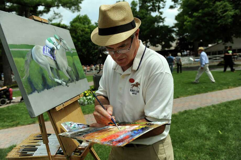 Artist Robert Clark works on an oil painting of Forever Together, a thoroughbred who won the Diana Grade I Stakes, in the paddock on Saturday, July 20, 2013, at Saratoga Race Course in Saratoga Springs, N.Y. (Cindy Schultz / Times Union) Photo: Cindy  Schultz / 10023141B