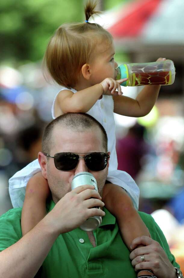 Mike Hofmann of Harding, N.J. and his daughter, Quinn, 22 months, drink their beverages of choice in the picnic area on Saturday, July 20, 2013, at Saratoga Race Course in Saratoga Springs, N.Y. (Cindy Schultz / Times Union) Photo: Cindy Schultz / 10023141B