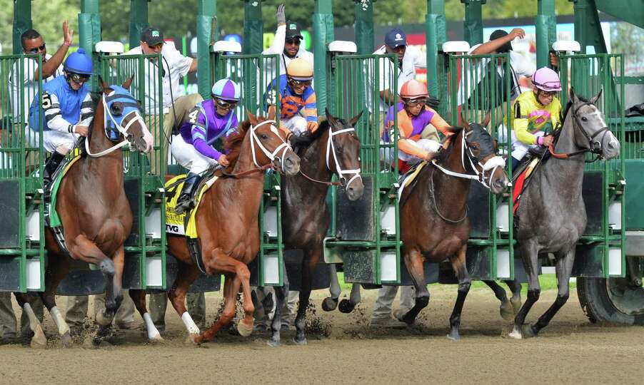 Horses break from the starting gate in the TVG Coaching Club American Oaks at Saratoga Race Course i