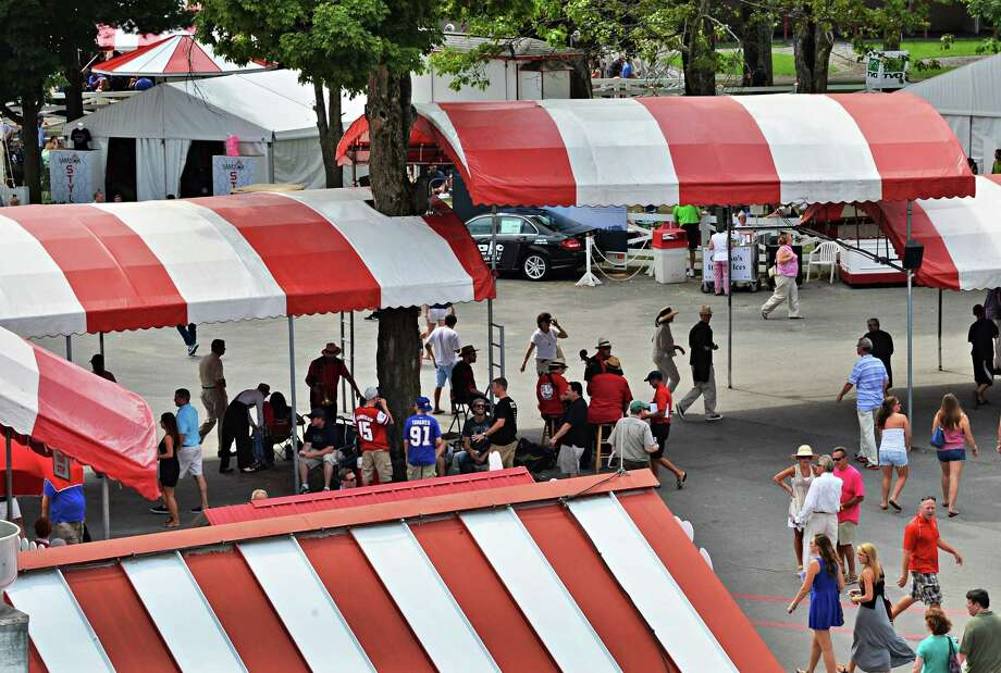 Red white striped canopies at Saratoga Race Course in Saratoga Springs, NY, Saturday July 20, 2013.  (John Carl D'Annibale / Times Union) Photo: John Carl D'Annibale / 10023141A