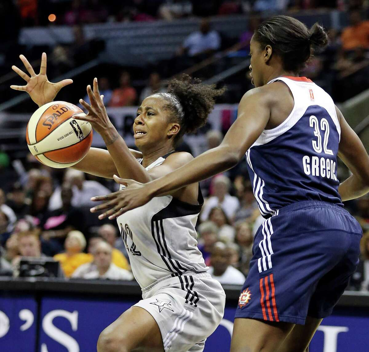 Silver Stars' Shenise Johnson grabs for a loose ball against Sun's Kalana Greene during first half action Saturday, July 20, 2013, at the AT&T Center.