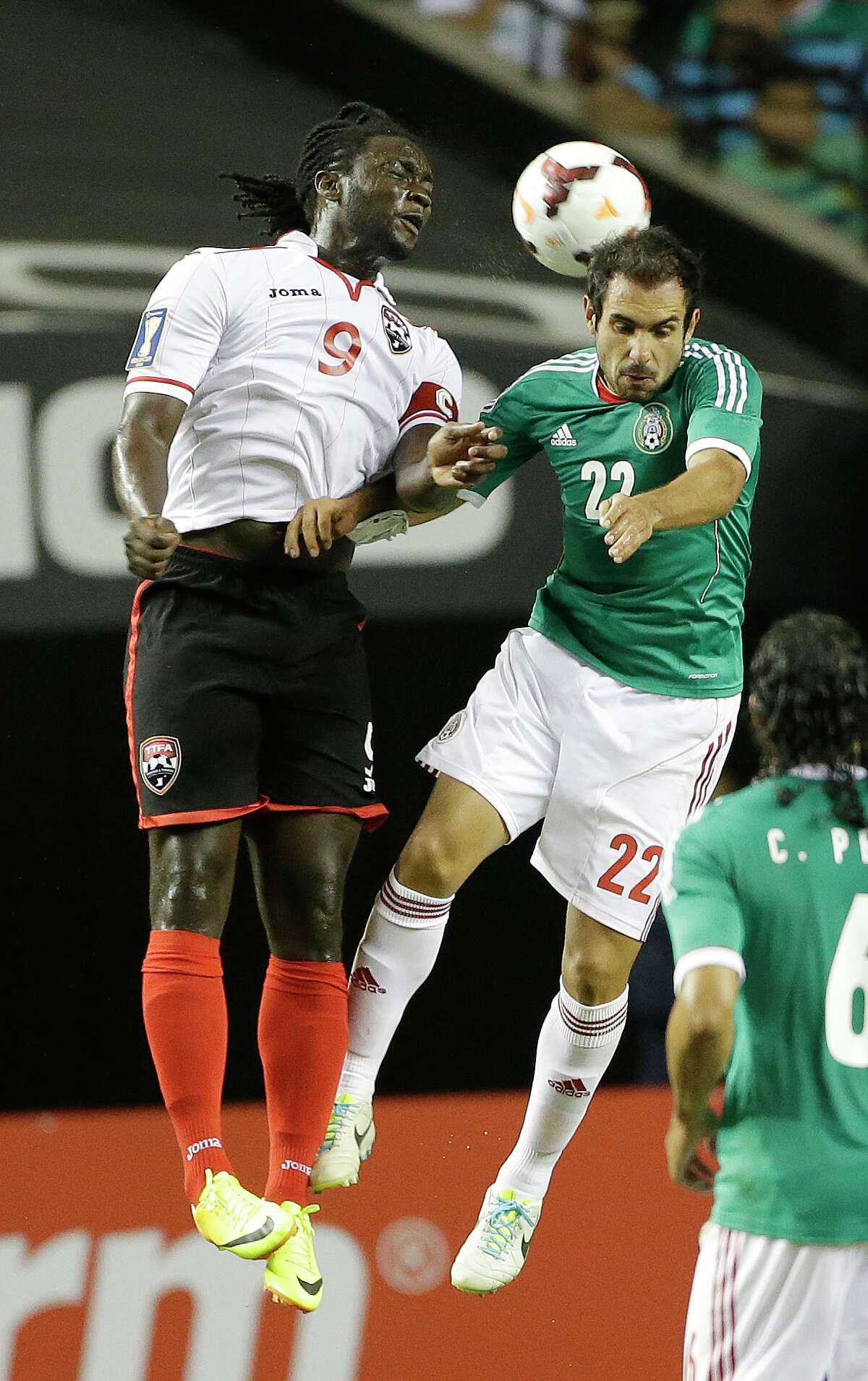 Trinidad & Tobago's Kenwyne Jones (9) and Mexico's Alejandro Castro fight for the ball during the second half in the quarterfinals of the CONCACAF Gold Cup soccer tournament, Saturday, July 20, 2013, in Atlanta. Mexico won 1-0. (AP Photo/John Bazemore)