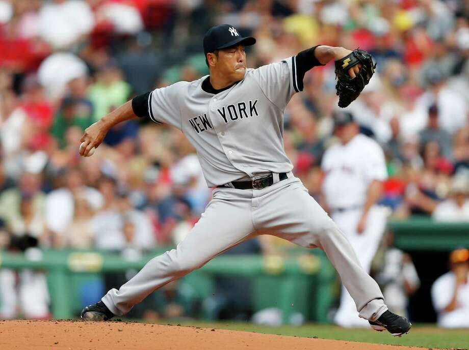 New York Yankees' Hiroki Kuroda, of Japan, pitches in the first inning of a baseball game against the Boston Red Sox in Boston, Saturday, July 20, 2013. (AP Photo/Michael Dwyer) ORG XMIT: MAMD103 Photo: Michael Dwyer / AP