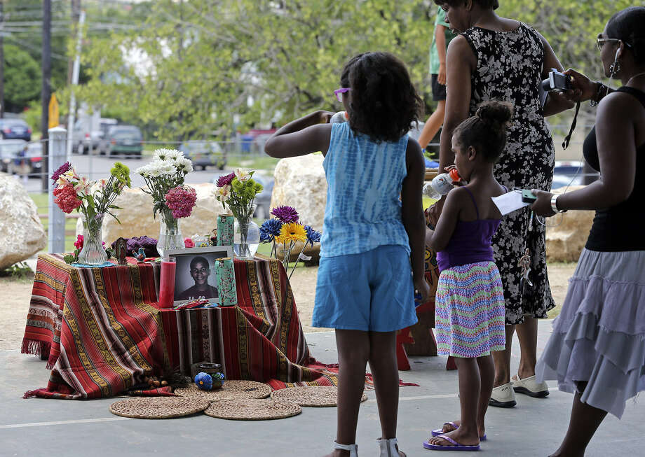 People view the memorial to young Trayvon Martin at Lockwood Park as San Antonians joined in the nationwide vigils. Photo: Photos By Tom Reel / San Antonio Express-News