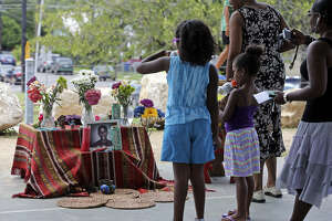 People view the memorial to young Trayvon Martin at Lockwood Park as San Antonians joined in the nationwide vigils.