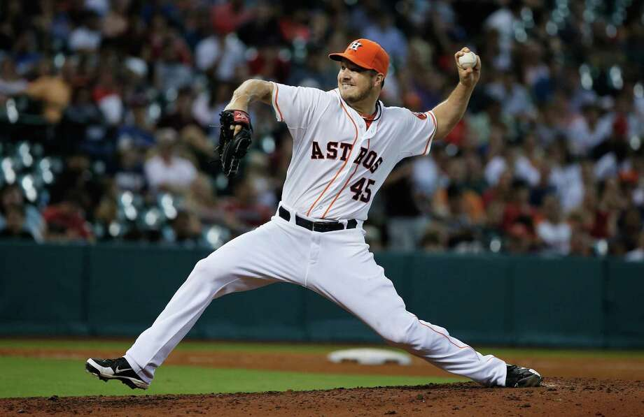 HOUSTON, TX - JULY 20:  Erik Bedard #45 of the Houston Astros throws a pitch in the fifth inning against the Seattle Mariners at Minute Maid Park on July 20, 2013 in Houston, Texas.  (Photo by Scott Halleran/Getty Images) ORG XMIT: 163494605 Photo: Scott Halleran / 2013 Getty Images