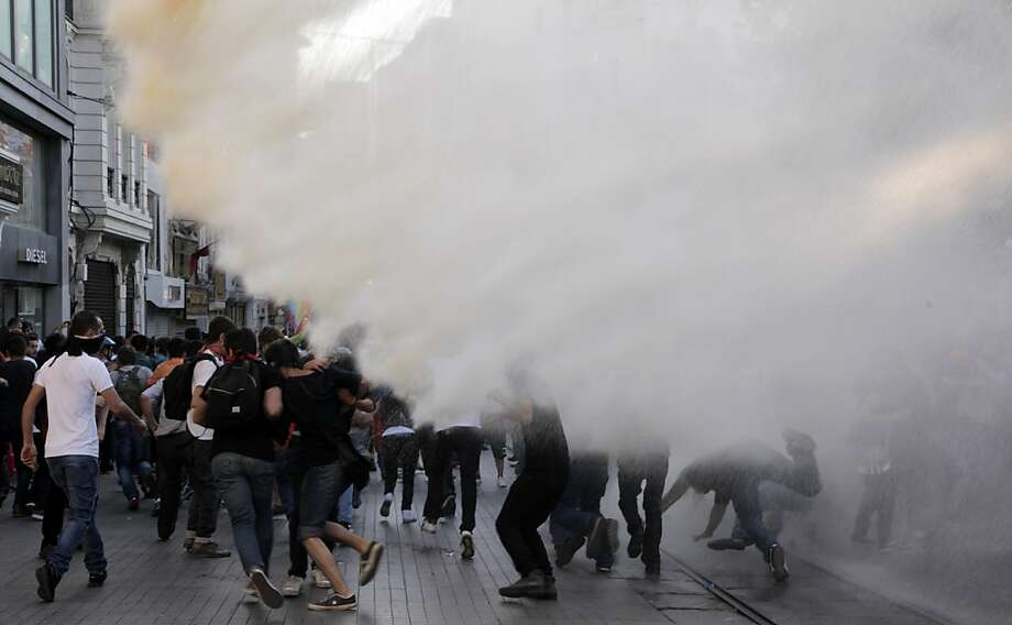 Turkish police disperse anti-government protestors with water cannons during a protest near the entrance of Taksim Square on July 20, 2013, in Istanbul. Police dispersed on July 20 hundreds of protesters who gathered around Gezi Park, the bastion of anti-government protests that shook Turkey in June, to attend the wedding of two protesters. AFP PHOTO / GURCAN OZTURKGURCAN OZTURK/AFP/Getty Images Photo: Gurcan Ozturk, AFP/Getty Images