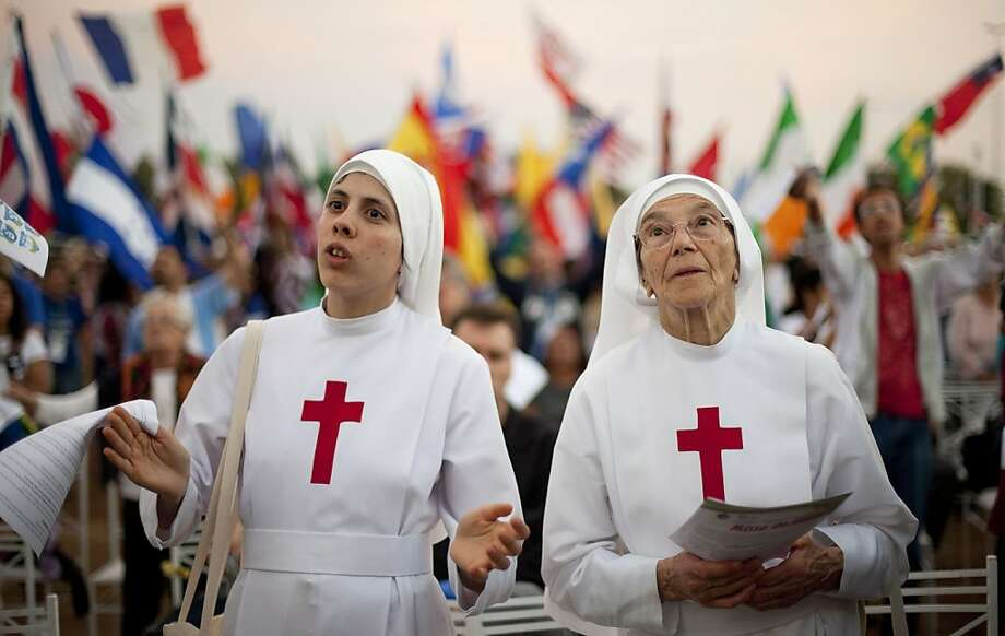 Nuns attend a Catholic Mass ahead of World Youth Day in Sao Paulo, Brazil, Saturday, July 20, 2013. Pope Francis will travel to Brazil and participate in WYD events from July 22-28. (AP Photo/Andre Penner) Photo: Andre Penner, Associated Press