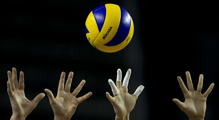 Bulgaria's players try to stop a spike from Brazil during a 2013 Volleyball World League semifinal match in Mar del Plata, Argentina, Saturday, July 20, 2013. Brazil won 3-1. (AP Photo/Natacha Pisarenko) Photo: Natacha Pisarenko, Associated Press
