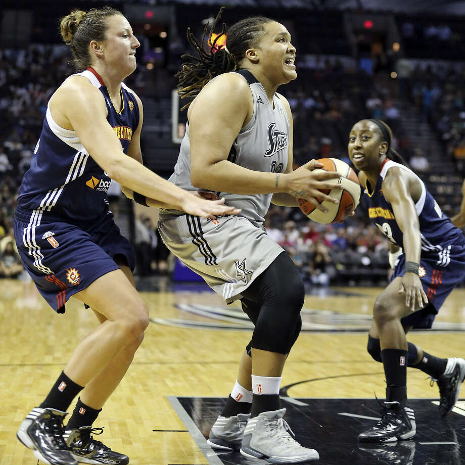 The Silver Stars' Danielle Adams, who had a season-high 20 points plus eight rebounds, drives past the Sun's Kelsey Griffin (left) in the second half. Photo: Edward A. Ornelas / San Antonio Express-News